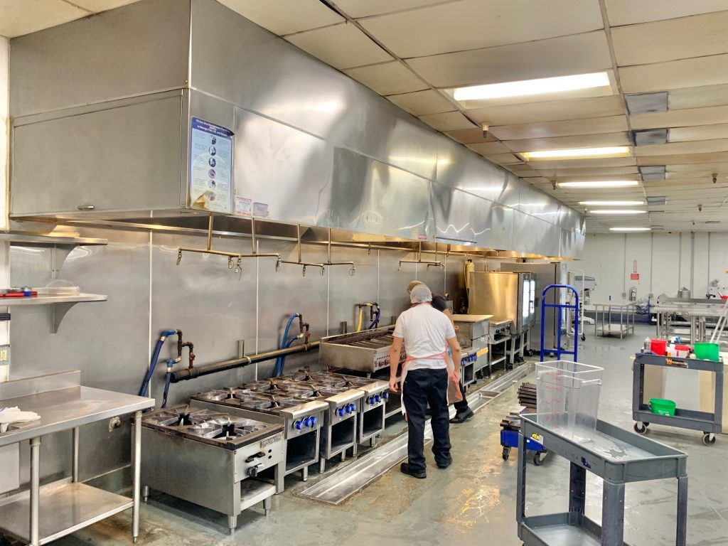 Long cooking hood in the commercial kitchen